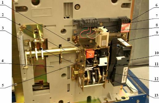 Рис.12.  Общий вид привода вакуумного выключателя серии ЭВОЛИС.  1-кнопка отключения; 2-синхронизирующий вал привода...